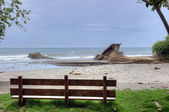 Wooden bench on a beach — Stock Photo