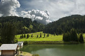 The small alpine lake — Stock Photo