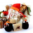 Stock Photo: SnowmSantClaus with gifts 1