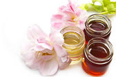 Honey and tulips — Stock Photo