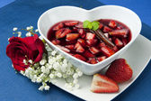Strawberries with red wine — Stock Photo