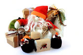 Snowman Santa Claus with gifts 1 — Stock Photo