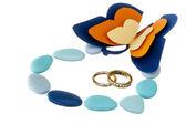 Snubní prsten a svatby laskavosti — Stock fotografie