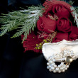 Bracelet of pearls and red roses — Stock Photo