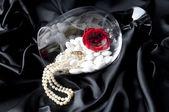 Yewelry on black fabric backroud — Stock Photo