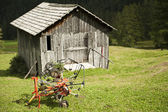 Agricultural implement and hut — Stock Photo