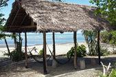 Hut on a deserted beach — Stock Photo