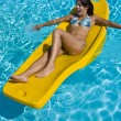 Girl relaxing in the pool on a floating mattress — Stock Photo #28374273