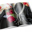 Stock Photo: Newspaper with pictures of necklace