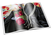 Newspaper with pictures of necklace — Stock Photo