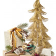 Golden Christmas tree and gifts — Stock Photo