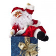 SantClaus sitting on parcel — Stock Photo #28488791