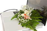 Flowers on the keyboard of a laptop — Stock Photo