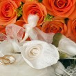Stock Photo: Wedding favors,wedding rings and roses