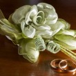 Stock Photo: Wedding favors and wedding rings