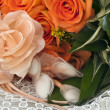 Stock Photo: Weeding Favors and orange roses
