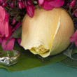 Yellow rose, flowers and jewelry — Stock Photo