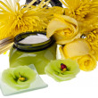 Yellow flowers ,candle and body lotion — Stock Photo