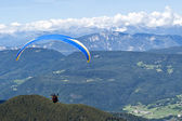 Paraglider flying over the Italian Alps — Stock Photo