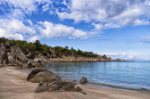 Sandy beach in Sithonia, Chalkidiki, Greece, under a cloudy sky — Stock Photo