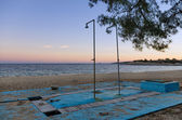 Abandoned shower at a deserted beach at dusk, in Sithonia, Chalkidiki, Greece — Stock Photo