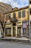 Old neoclassical building in Florina, a popular winter destination in northern Greece, on an overcast day — Stock Photo