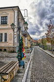 Street with old neoclassical buildings by the river in Florina, a popular winter destination in northern Greece, on an overcast day — Stock Photo