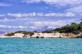 Rocky coast in Sithonia, Chalkidiki, Greece, with Mount Athos at the background — Stock Photo