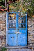 Old blue metallic gate in Parthenonas village, Sithonia, Chalkidiki, Greece — Stock Photo