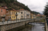 Old neoclassical buildings by the river in Florina, Greece — Stock Photo