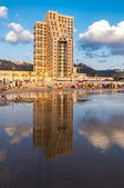 Haifa. Carmel Beach and a hotel with reflection in a water of Haifa Bay — Stock Photo