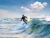 Surfers riding mediterranean wave — Stock Photo