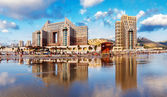 Haifa. Carmel Beach and a hotels with reflection in a water of Mediterranean sea — Stock Photo