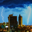 Thanderstorm over night city. — Stock Photo #33333113