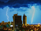 Thanderstorm over night city. — Stock Photo