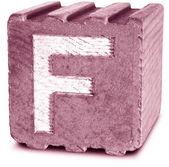 фотография пурпурный деревянный блок букву f — Стоковое фото