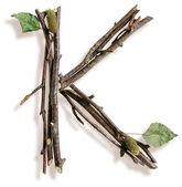 Natural rama y palo letra k — Foto de Stock