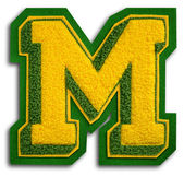 Photograph of School Sports Letter - Green and Yellow M — Stock Photo