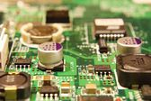 PCB with populated components on green layer — Stock Photo