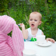 Little Girl feeding Pink Bunny Rabbit — Stock Photo #33448603