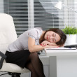 Young woman sleeping on a table in the office  — Foto Stock