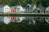 Small houses on the bank of lake — Stock Photo
