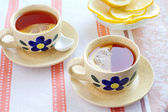 Two cups of black tea with lemon — Stock Photo