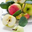 Apples with leaves on a tray — Stock Photo