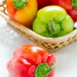 Ripe peppers in wattled basket — Stock Photo