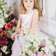 Portrait of little cute girl with flowers — Stock Photo #29131883