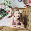 Portrait of a little girl lying on the couch — Stock Photo #29131895