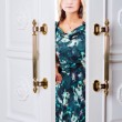 Stockfoto: Young womcomes out of door