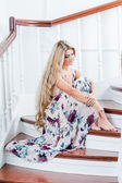 Attractive young lady sitting on the stairs — Stock Photo