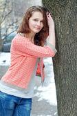 Young happy girl posing outdoor — Stock Photo